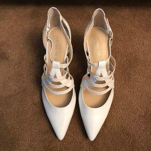 White patent leather kitten heels